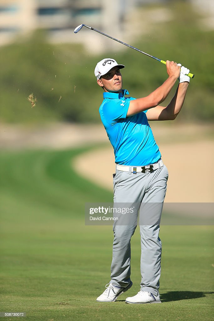 Haydn Porteous of South Africa plays his second shot at the par 4, 14th hole during the third round of the 2016 Omega Dubai Desert Classic on the Majlis Course at the Emirates Golf Club on February 6, 2016 in Dubai, United Arab Emirates.