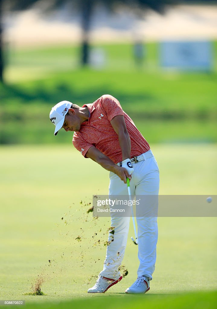 Haydn Porteous of South Africa plays his second shot at the par 4, first hole during the final round of the 2016 Omega Dubai Desert Classic on the Majlis Course at the Emirates Golf Club on February 7, 2016 in Dubai, United Arab Emirates.