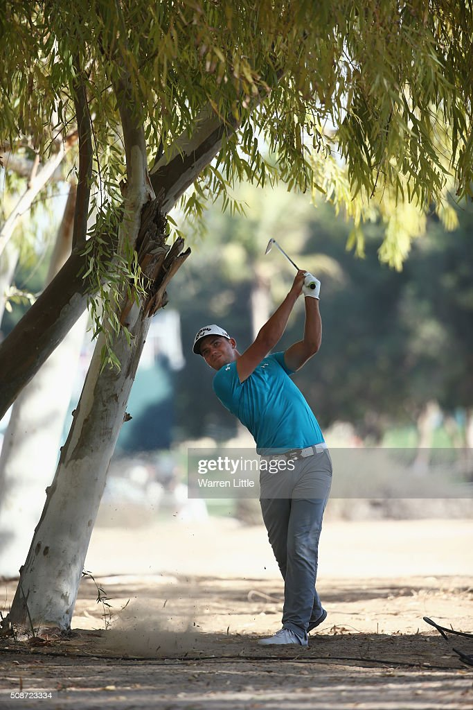 Haydn Porteous of South Africa plays his second shot on the 18th hole during the third round of the Omega Dubai Desert Classic at the Emirates Golf Club on February 6, 2016 in Dubai, United Arab Emirates.