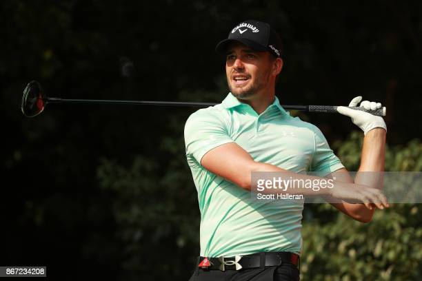 Haydn Porteous of South Africa plays his shot from the ninth tee during the second round of the WGC HSBC Champions at Sheshan International Golf Club...