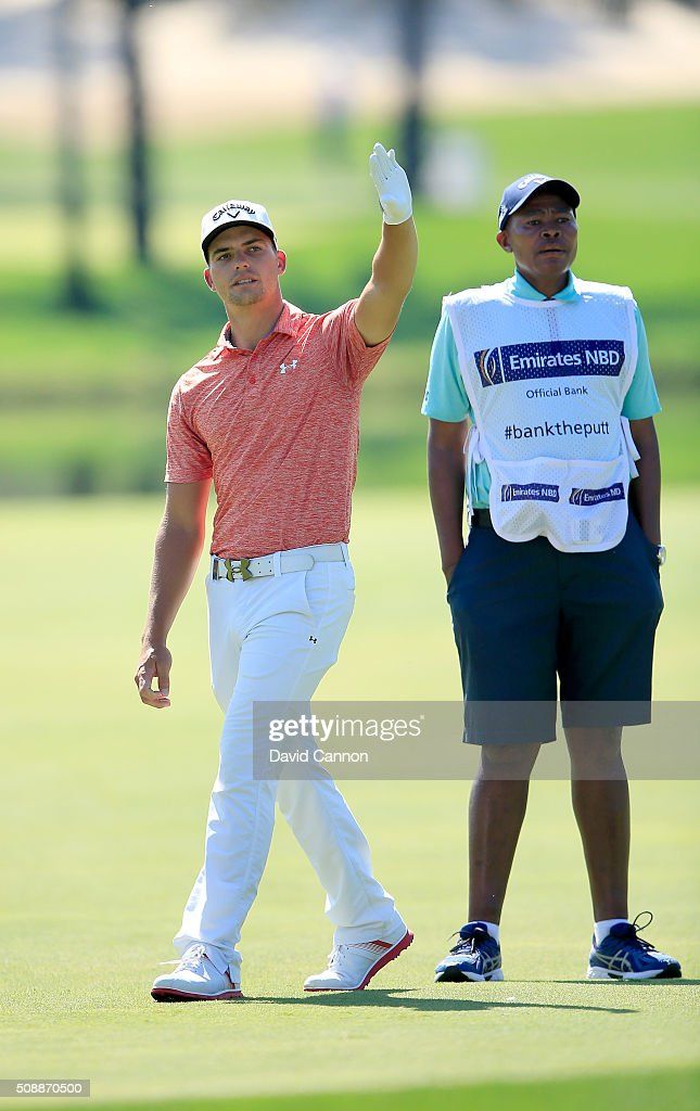 Haydn Porteous of South Africa prepares to play his second shot at the par 4, first hole during the final round of the 2016 Omega Dubai Desert Classic on the Majlis Course at the Emirates Golf Club on February 7, 2016 in Dubai, United Arab Emirates.