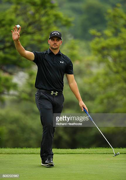 Haydn Porteous of South Africa reacts to a birdie putt on the 18th green during the third round of the Joburg Open at Royal Johannesburg and...