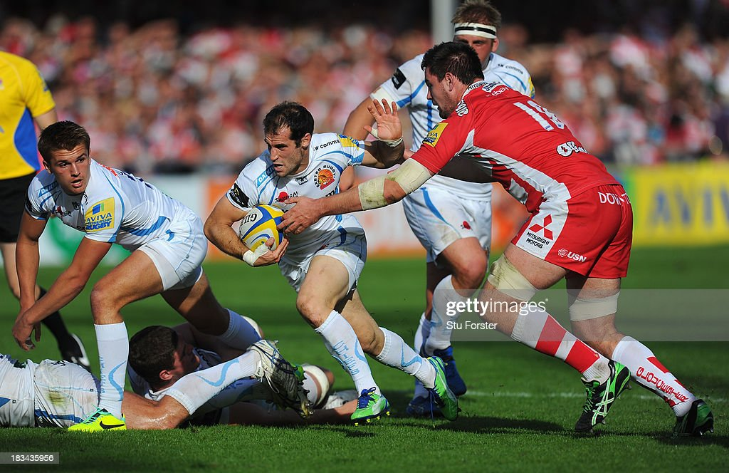 <a gi-track='captionPersonalityLinkClicked' href=/galleries/search?phrase=Haydn+Thomas&family=editorial&specificpeople=504716 ng-click='$event.stopPropagation()'>Haydn Thomas</a> of Exeter races past Elliott Stooke of Gloucester during the Aviva Premiership match between Gloucester and Exeter Chiefs at Kingsholm Stadium on October 6, 2013 in Gloucester, England.