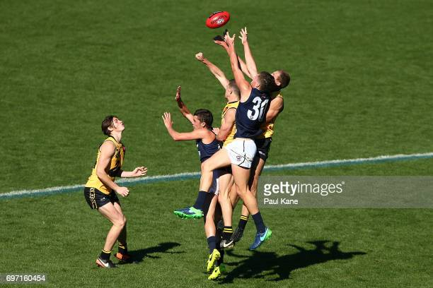 Haydyn McLean of Vic Metro contests a mark against Louis Miller and Aaron Naughton of Western Australia during the U18 Championships match between...
