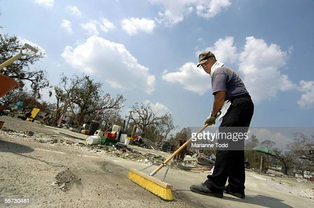 Hayes Bolton cleans up what was his Lighthouse Pawn Shop along US 90 September 20 2005 in Biloxi Mississippi Bolton said many businesses with local...