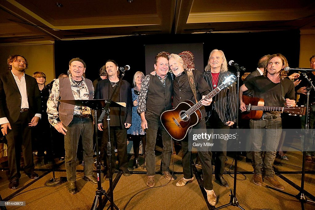 Hayes Carll, Butch Hancock, Jimmy LaFave, Kimmie Rhodes, Joe Ely, Kris Kristofferson, Jimmie Dale Gilmore and Lukas Nelson perform during the Nobelity Projects Artists & Filmmakers Dinner honoring Kris Kristofferson with the Feed The Peace award at the Four Seasons Hotel on February 10, 2013 in Austin, Texas.