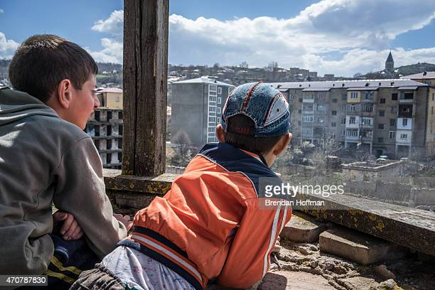Hayk Harutyunyan and Vanya Hambartzumyan look from the top of one of the minarets of the Lower Mosque on April 19 2015 in Shushi NagornoKarabakh...