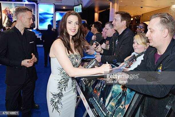 Hayley Atwell and Evan Jones attend the UK Film Premiere of 'Captain America The Winter Soldier' at Westfield London on March 20 2014 in London...