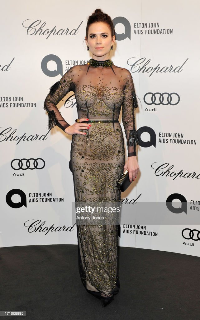 Hayley Atwell attends the 15th Annual White Tie and Tiara Ball to Benefit Elton John AIDS Foundation in Association with Chopard at Woodside on June 27, 2013 in Windsor, England. No sales to online/digital media worldwide until the 14th of July. No sales before July 14th, 2013 in UK, Spain, Switzerland, Mexico, Dubai, Russia, Serbia, Bulgaria, Turkey, Argentina, Chile, Peru, Ecuador, Colombia, Venezuela, Puerto Rico, Dominican Republic, Greece, Canada, Thailand, Indonesia, Morocco, Malaysia, India, Pakistan, Nigeria. All pictures are for editorial use only and mention of 'Chopard' and 'The Elton John Aids Foundation' are compulsory. No sales ever to Ok, Now, Closer, Reveal, Heat, Look or Grazia magazines in the United Kingdom. No sales ever to any jewellers or watchmakers other than Chopard