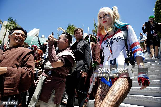 SAN DIEGO CA THURSDAY JULY 21 2016 Hayley Blumberg as Harley Quinn passes by a Star Wars cosplay gathering outside the Convention Center during day...