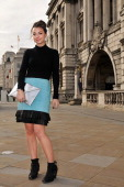 Hayley Intern to Holly Fulton wearing Holly Fulton blue leather skirt with fringe detail Black Wolford top H M silver bag Hermes braclet earrings...