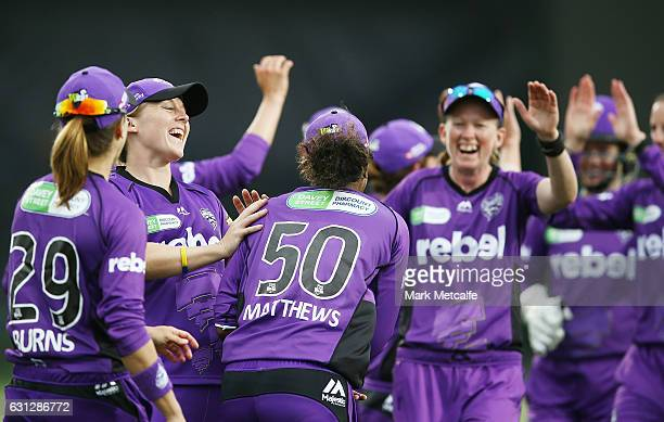 Hayley Matthews of the Hurricances celebrates with team mates after taking the wicket of Kirby Short of the Heat during the Women's Big Bash League...