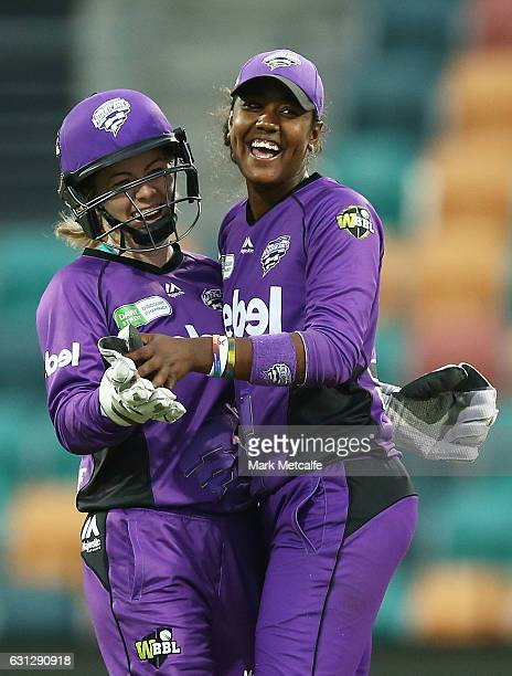 Hayley Matthews of the Hurricances celebrates with team mates after taking a wicket during the Women's Big Bash League match between the Brisbane...