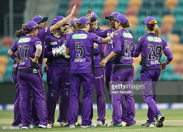 Hayley Matthews of the Hurricances celebrates with team mates after taking the wicket of Delissa Kimmince of the Heat during the Women's Big Bash...
