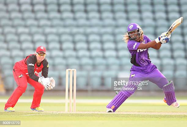 Hayley Matthews of the Hurricanes bats as wicketkeeper Rachel Priest of the Renegades looks on during the Women's Big Bash League match between the...
