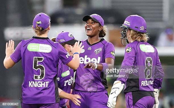 Hayley Matthews of the Hurricanes is congratulated by her teammates after dismissing Alex Blackwell of the Thunder during the Women's Big Bash League...