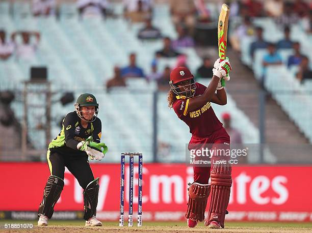 Hayley Matthews of the West Indies hits the ball towards the boundary as Alyssa Healy of Australia looks on during the Women's ICC World Twenty20...