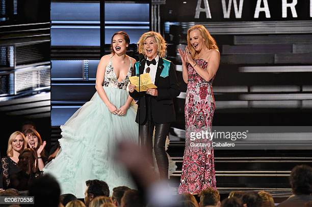 Hayley Orrantia Olivia NewtonJohn and Wendi McLendonCovey speak onstage at the 50th annual CMA Awards at the Bridgestone Arena on November 2 2016 in...