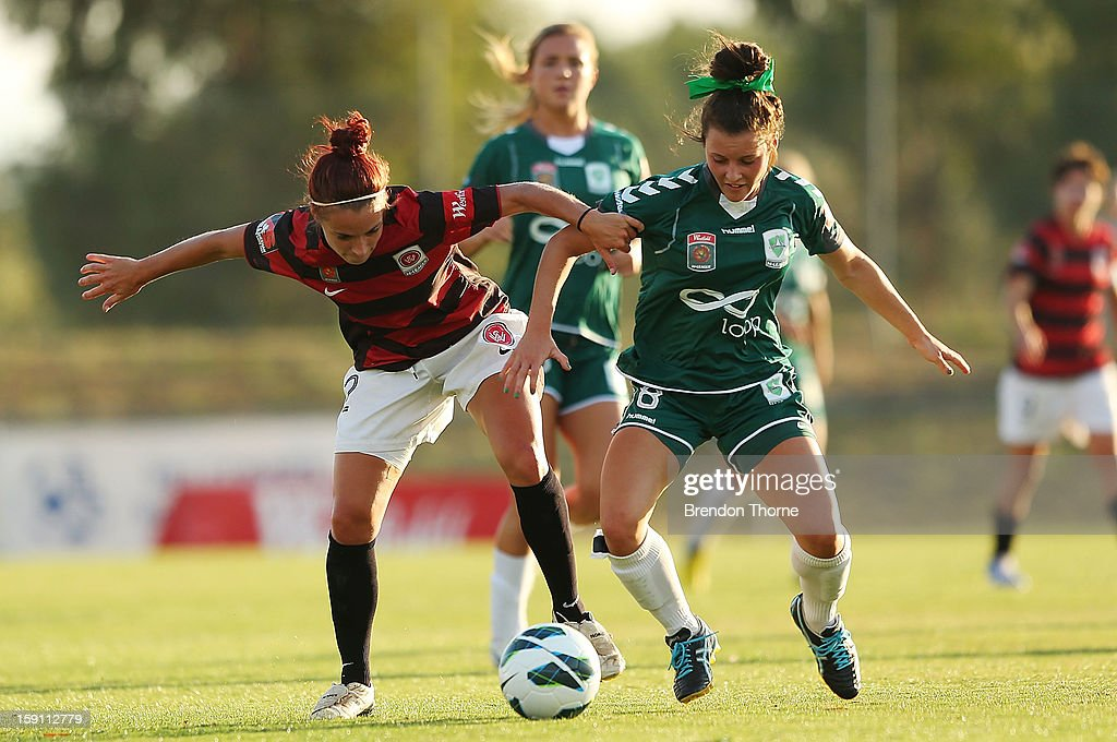 Hayley Raso of Canberra competes with Samantha Spackman of the Wanderers during the round 11 W-League match between Canberra United and the Western Sydney Wanderers at McKellar Park on January 8, 2013 in Canberra, Australia.