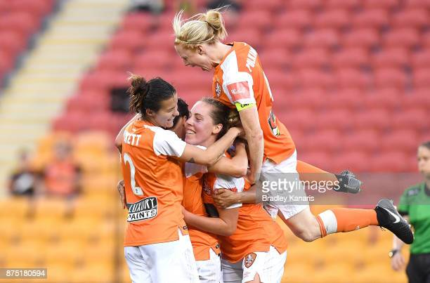 Hayley Raso of the Roar is congratulated by team mates after scoring a goal during the round four WLeague match between Brisbane and Adelaide at...