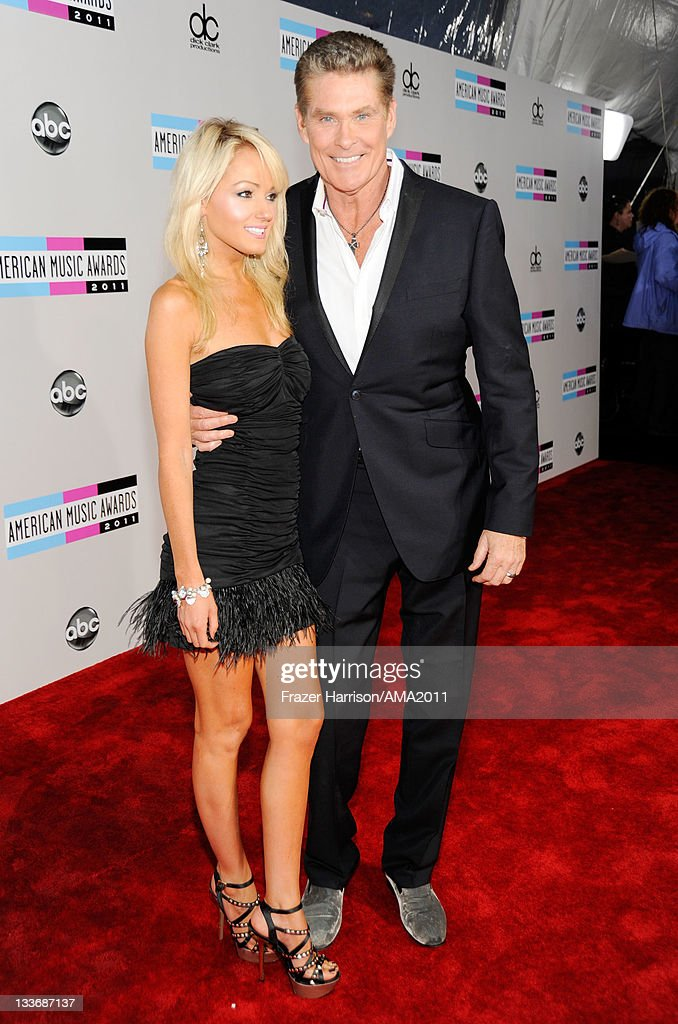 Hayley Roberts and David Hasselhoff arrive at the 2011 American Music Awards held at Nokia Theatre L.A. LIVE on November 20, 2011 in Los Angeles, California.