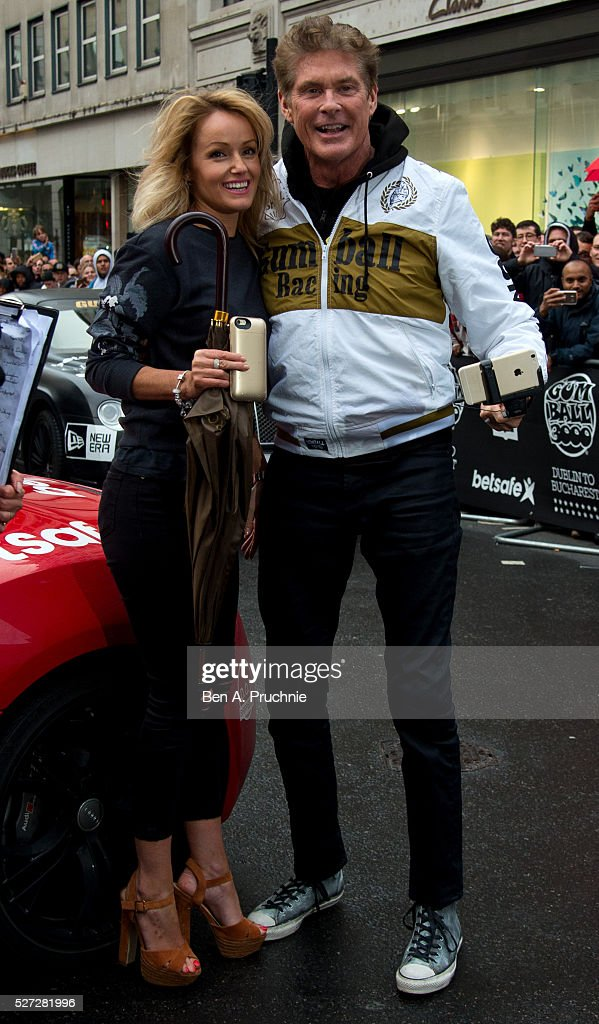 Hayley Roberts and David Hasselhoff pose for photographers as Gumball Rally closes down Regent Street at Regent Street on May 3, 2016 in London, England.