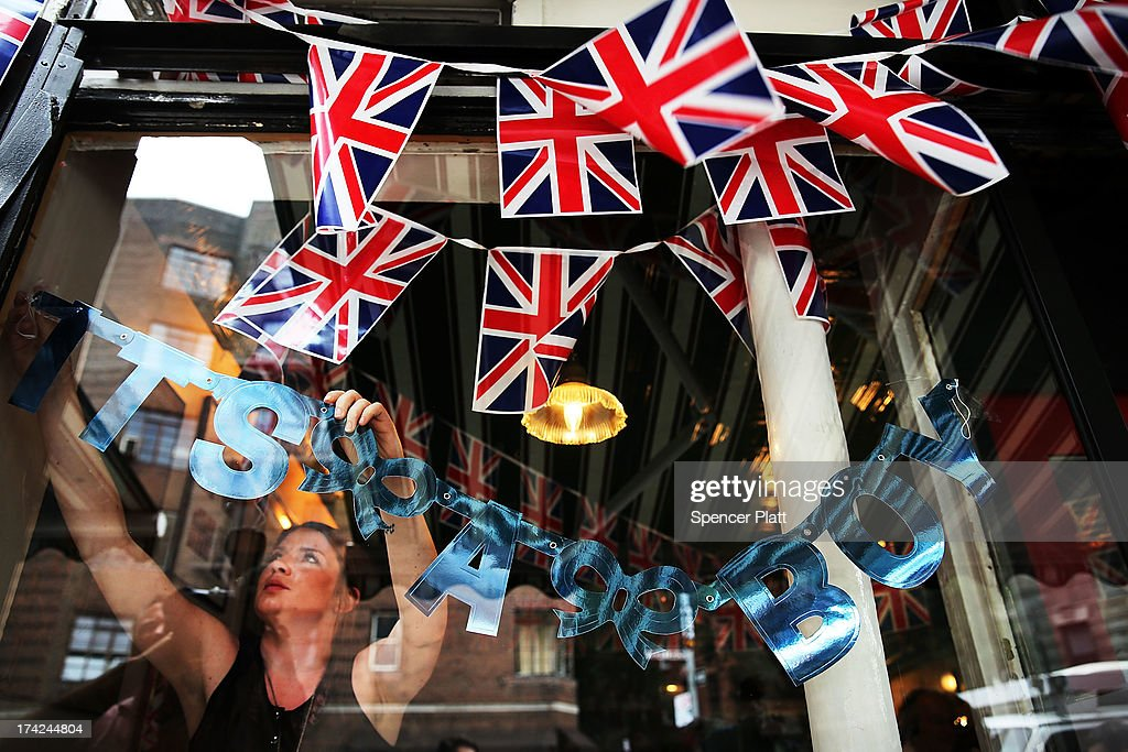 Hayley Simmonds, an employee at the British restaurant and grocery Tea & Sympathy, hangs a sign in the window celebrating the birth of Catherine, Duchess of Cambridge, and her husband Prince William's first child on July 22, 2013 in New York City. The Royal couple had a baby boy who was born at 16.24 BST and weighed 8 pounds, 6 ounces. The child, who is now third in line to the throne, has yet to be named.
