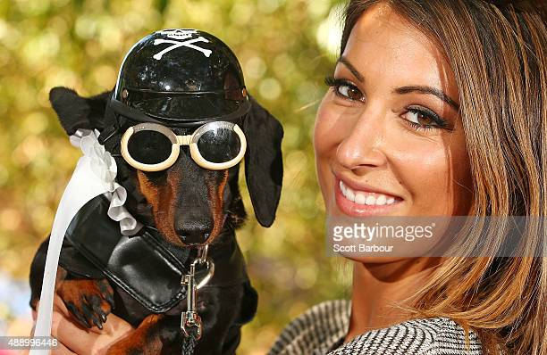 Hayley Swanson poses with her mini dachshund Chilli dressed as a biker dog as she competes in the Hophaus Southgate Inaugural Best Dressed Dachshund...