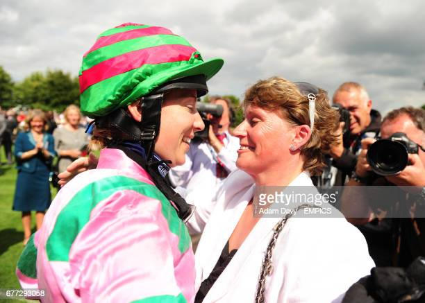 Hayley Turner is greeted by ex Jockey Alex Greaves and first Woman to win a Group 1 Race