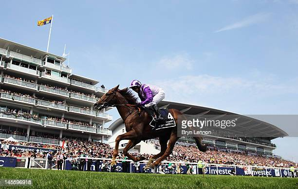 Hayley Turner riding Cavaleiro in action during the Investec Derby at the start of the weekend marking the Queen's Diamond Jubilee celebrations at...