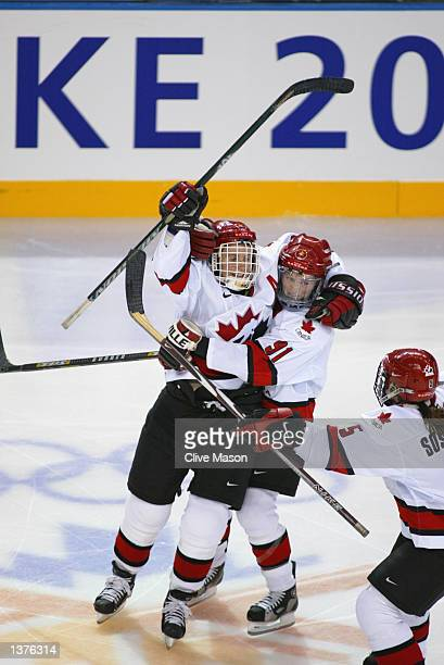 Hayley Wickenheiser of Canada celebrates with teammate Geraldine Heaney against the USA during the womens ice hockey gold medal game at the Salt Lake...