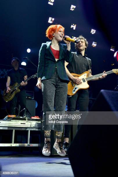 Hayley Williams and Taylor York of Paramore perform onstage during KISS 108's Jingle Ball 2013 at TD Garden on December 14 2013 in Boston MA