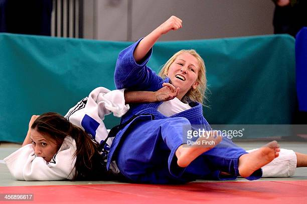 Hayley Willis celebrates throwing Kimberley Renicks for ippon to win the u48kg gold medal at the British Senior Judo Championships on Sunday December...
