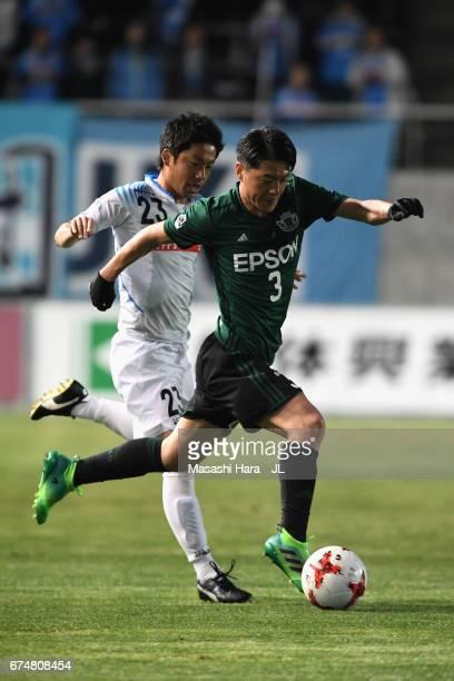 Hayuma Tanaka of Matsumoto Yamaga and Hironori Nishi of Kamatamare Sanuki compete for the ball during the JLeague J2 match between Matsumoto Yamaga...