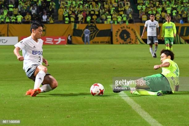 Hayuma Tanaka of Matsumoto Yamaga and Takaya Inui of JEF United Chiba compete for the ball during the JLeague J2 match between JEF United Chiba and...