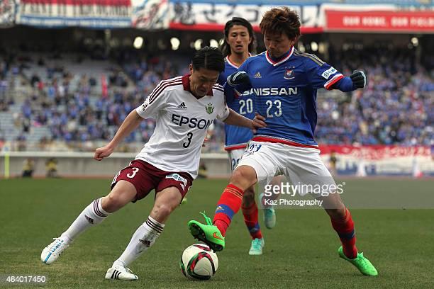 Hayuma Tanaka of Matsumoto Yamaga and Takumi Shimohira of Yokohama FMairnos compete for the ball during the JLeague 2015 preseason match between...