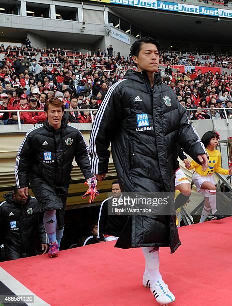 Hayuma Tanaka of Matsumoto Yamaga enters a pitch prior to the JLeague match between Urawa Red Diamonds and Matsumoto Yamaga at Saitama Stadium on...