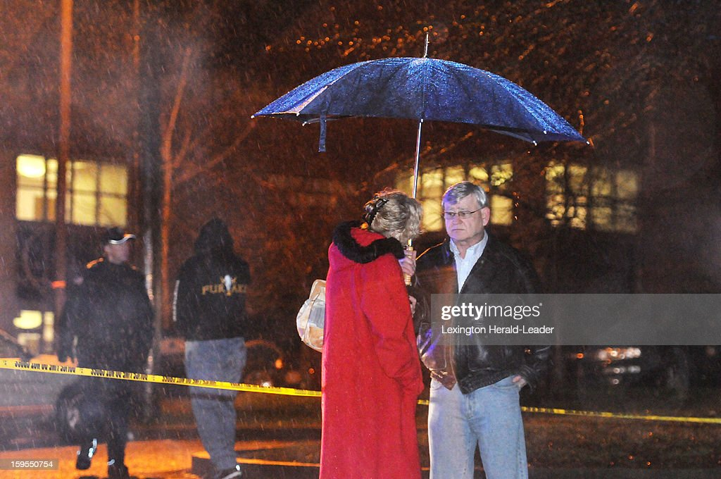 Hazard Community and Technical College Senior Director of Advancement Ron Daley, right, stands in a parking lot on campus where at least two people were killed and one person was injured Tuesday evening on January 15, 2013.