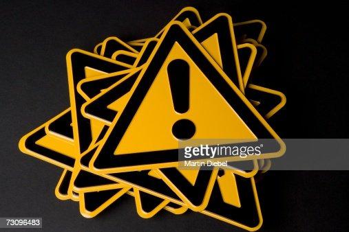?Hazard? warning sign on top of stack