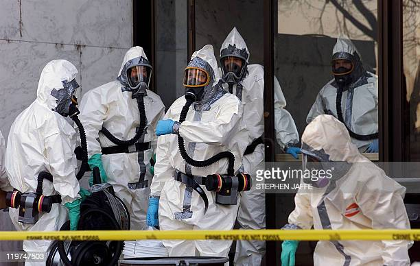 Hazardous materials experts enter the Hart Building of the US Senate 07 November 2001 in Washington DC The Hart Building has been closed after an...