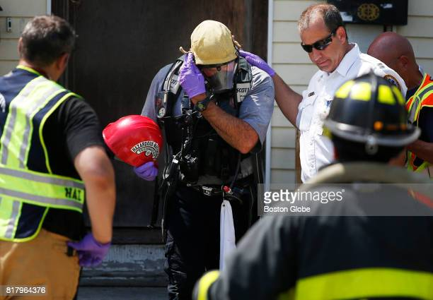 Hazardous Materials technician removes his mask after leaving the scene of an overdose that killed two people in Lawrence MA on Jul 17 2017 The...