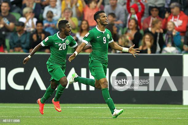 Hazazi Naif of Saudi Arabia celebrates with teammate Nawaf Alabid of Saudi Arabia after scoring a goal during the 2015 Asian Cup match between DPR...