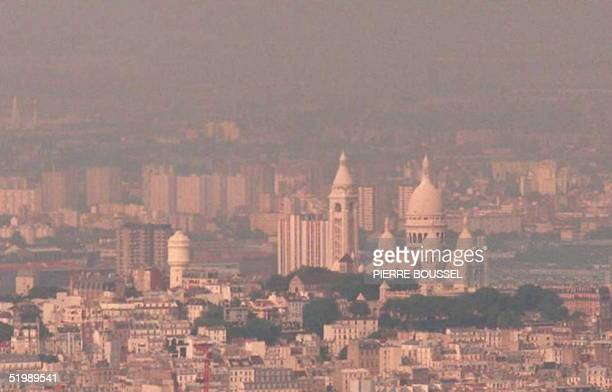 A haze caused by air pollution hangs over Montmartre and the Sacre Coeur cathedral in Paris 21 July The current heatwave has raised the...