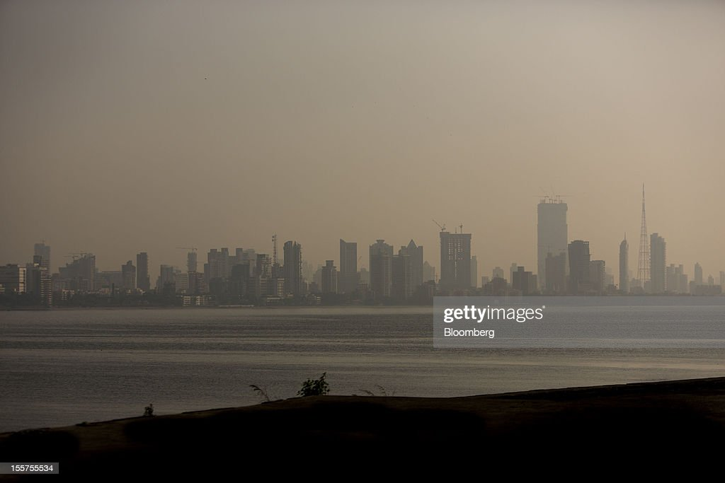 Haze hangs over the skyline in Mumbai, India, on Tuesday, Nov. 6, 2012. Reserve Bank of India Governor Duvvuri Subbarao lowered the RBI's forecast for India's gross domestic product growth in the year through March to 5.8 percent, the slowest in almost a decade, from 6.5 percent. Photographer: Brent Lewin/Bloomberg via Getty Images