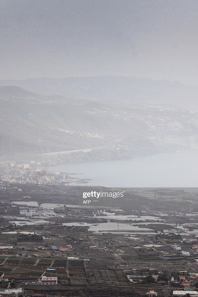 Haze hovers over Guimar on April 20, 2013 on the Spanish Canary island of Tenerife, where temperatures are soaring due to the Sirocco, a Mediterranean wind coming from the Sahara.