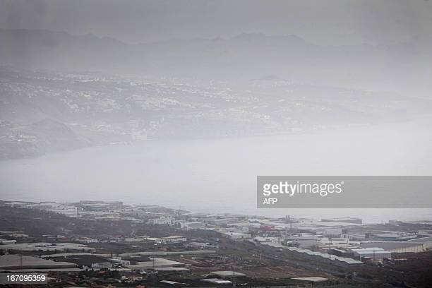 Haze hovers over Guimar on April 20 2013 on the Spanish Canary island of Tenerife where temperatures are soaring due to the Sirocco a Mediterranean...