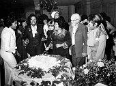 Hazel Gordy Jackson cuts her cake at surprise baby show at Beverly Hills Hotel with Nancy Wilson Burton Barbara Mitchell Iris Gordy Glodean White...