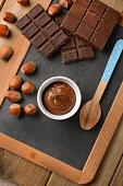 Hazelnut chocolate cream in white bowl - closeup