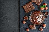 Hazelnut spread with nuts and chocolate bar