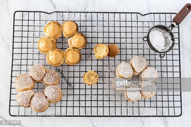 Hazelnut madeleines with caramel sauce on a cooling rack
